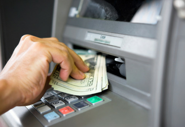 Cash being deposited to ATM